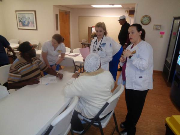 Nursing students speaking to residents
