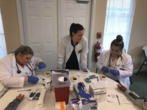nursing students preparing free health screening tests